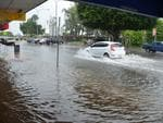 Flash flooding inundates the Ayr CBD. Photo by Rachel Afflick.