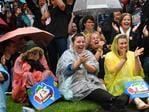 The crowd cheers in the rain in Adelaide as the result is read out. Picture: AAP/David Mariuz