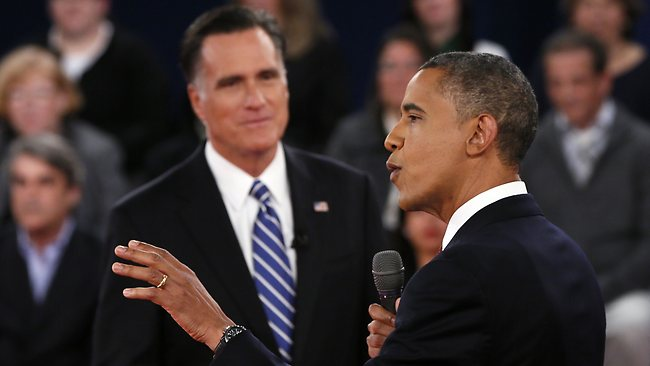 US President Barack Obama makes a point during the second presidential debate on October 16, 2012 at Hofstra University in Hempstead, New York in a 90-minute town hall-style debate. Obama and Republican presidential candidate Mitt Romney face off Tuesday in a make-or-break debate, vying for command of the presidential race just three weeks from election day. AFP PHOTO / Shannon STAPLETON - POOL