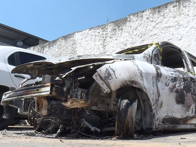 Grab taken from an AFP video showing the burnt-out rental car of missing Greek ambassador to Brazil Kyriakos Amiridis. Picture: AFP
