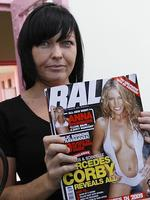 2008 - Schapelle Corby holding a copy of Ralph magazine with her sister Mercedes on the cover, during a Christmas party in Kerobokan Jail in Bali. Picture: Supplied