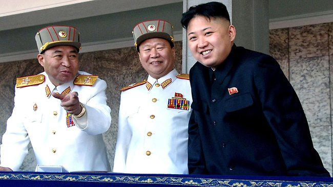 North Korean leader Kim Jong Un smiles with Korean People's Army Vice Marshal and Vice Chairman of the Central Military Commission Choe Ryong Hae, centre, and former Vice Marshal and the military's General Staff Chief Ri Yong Ho. (AP Photo/Korean Central News Agency via Korea News Service)