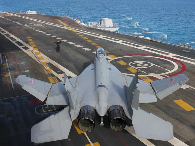 a russian mig 29k moves into position aboard admiral kuznetsovs flight deck picture