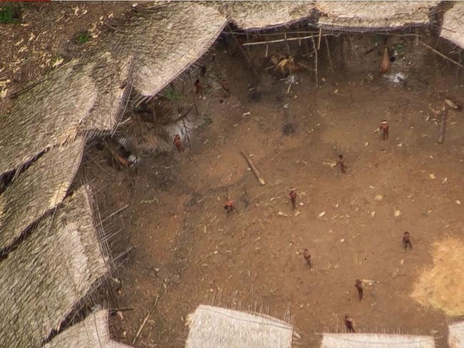 Inhabitants of an uncontacted Yanomami yano (communal house) in the Brazilian Amazon. Picture: Guilherme Gnipper Trevisan/Hutukara