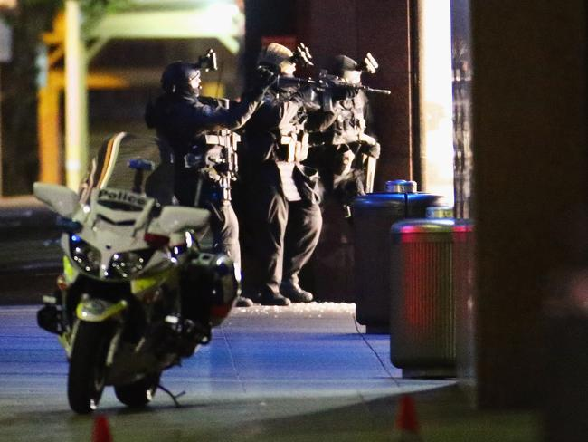 Heavily armed police take aim outside the Lindt Cafe in Martin Place. Picture: Don Arnold/Getty Images