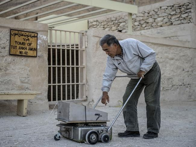 Deep scan ... Japanese expert Hirokatsu Watanabe checks his radar equipment outside King Tutankhamun's burial chamber in the Valley of Kings near Luxor in southern Egypt. Source: AFP