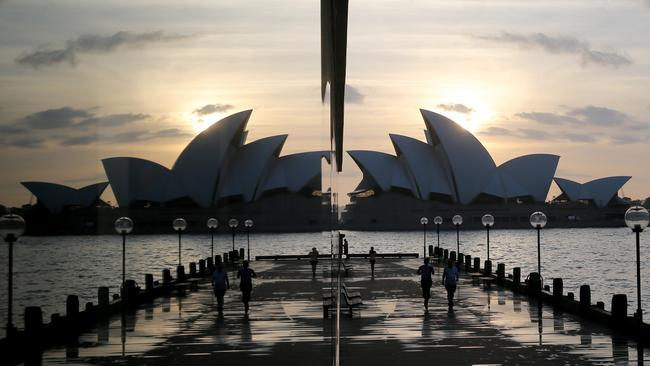 A wet Sydney Opera House sunrise is still magnificent