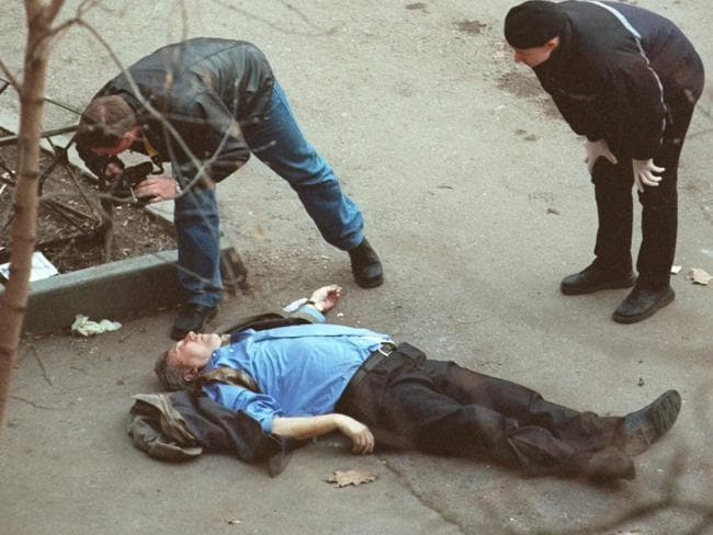 Police photograph the body of assassinated Liberal Russia party leader Sergei Yushenkov outside his Moscow apartment. Picture: File