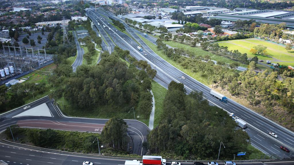 Artists Impression Of The M4 East At Homebush Bay Drive People Working To Construct