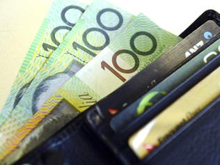 $100 Australian dollar notes pop out of a wallet with credit cards, pictured in Brisbane, Tuesday, Aug. 20, 2013. (AAP Image/Dan Peled) NO ARCHIVING
