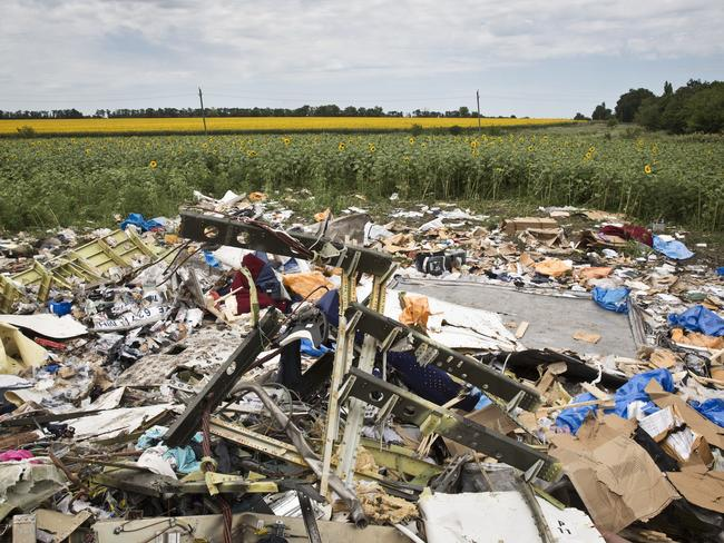 Debris and objects scattered on the ground where MH17 fell from the sky.