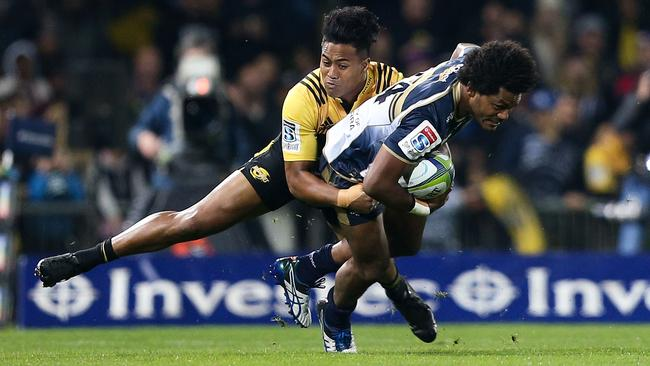Brumbies winger Henry Speight is tackled by Hurricanes star Julian Savea during their clash earlier this season.