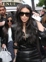 All dressed in ... leather? Kim Kardashian and Kourtney Kardashian leave at a restaurant in Paris, May 22, 2014. The gates of the Chateau de Versailles, once the digs of Louis XIV, will be thrown open to Kim Kardashian, Kanye West and their guests for a private evening this week ahead of their marriage . Picture: AP