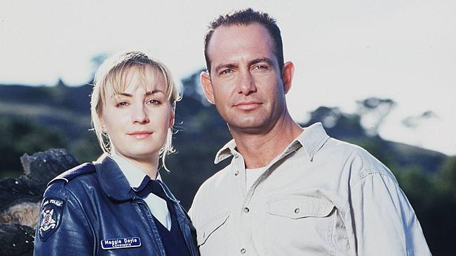 1997. Actors Lisa McCune and Martin Sacks in the TV show 'Blue Heelers'.