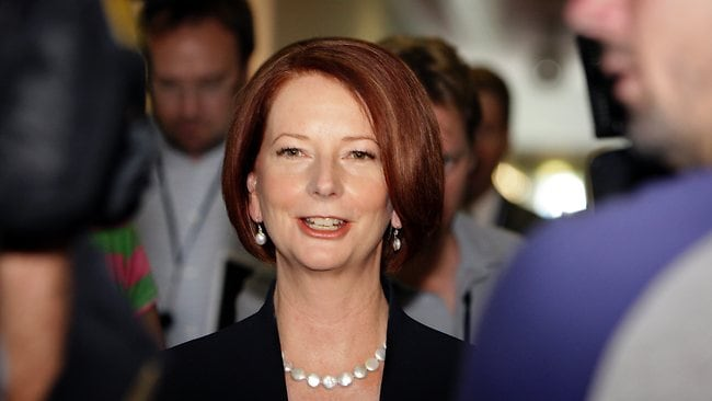 PM Julia Gillard surrounded by media as she leaves Channel Ten's Parliament House TV studio after appearing on Meet The Press this morning. Picture: Ray Strange