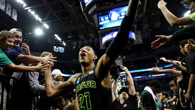 The Baylor Bears celebrate with fans after defeating the Creighton Bluejays in the third round of the 2014 NCAA Men's Basketball Tournament.