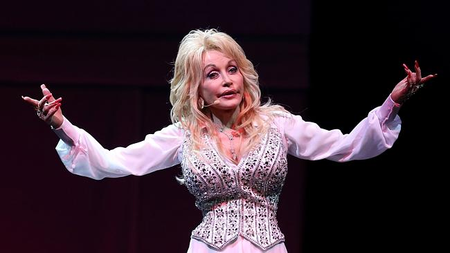 "Dolly's literacy program, ""Dolly Parton's Imagination Library"", mails one book per month to each enr..."