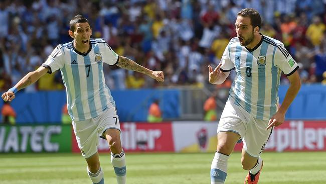Argentina's Gonzalo Higuain, right, celebrates with Angel di Maria.