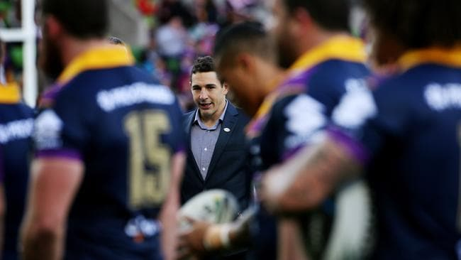 The injured Billy Slater watches on.