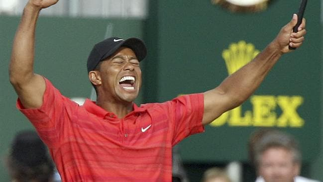 Tiger Woods celebrates his victory at Hoylake in 2006.