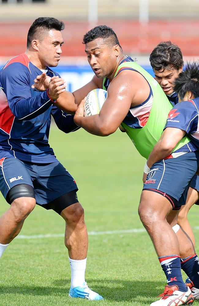 Male Sau (L) in action at a Rebels training session. Picture: Josie Hayden
