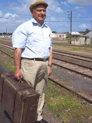 Italian migrant John Bueti — with the original suitcase he brought from Italy.