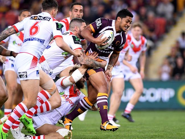 Anthony Milford of the Broncos breaks through the defence.