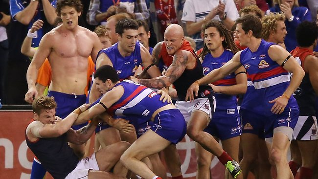 Ugly ... A melee breaks out after the half-time siren.