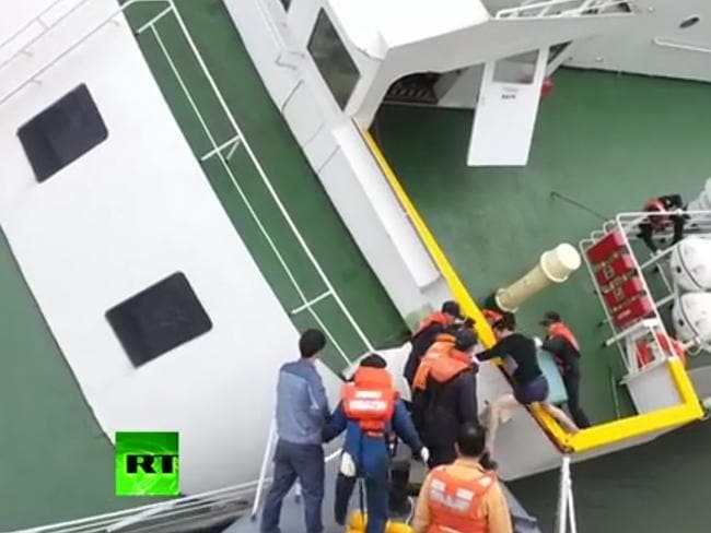 Helping himself ... footage showing the doomed ferry's captain scrambling to safety in hi