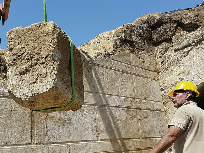 Block by block ... In this handout photo released by the Greek Culture Ministry, workers remove one of the large stone blocks from a wall originally sealing the entrance to an ancient tomb under excavation at Amphipolis in northern Greece. Source: AP