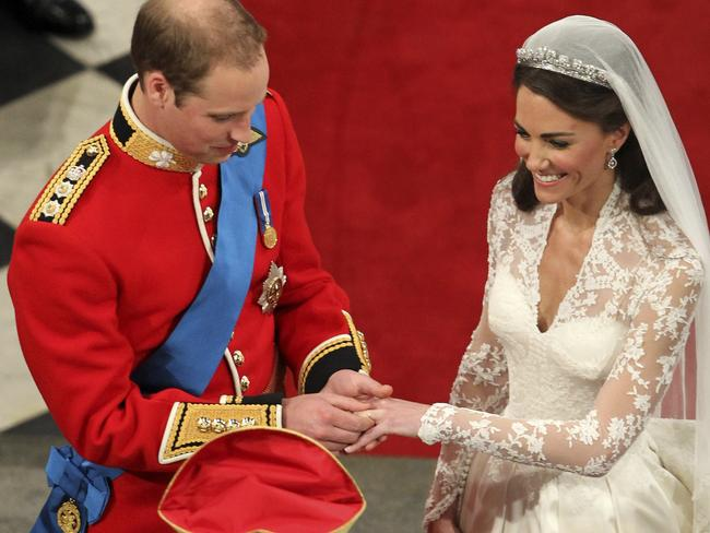 The traditional plain gold wedding band now sits next to the much larger engagement ring. Picture: AP Photo/Andrew Milligan, Pool