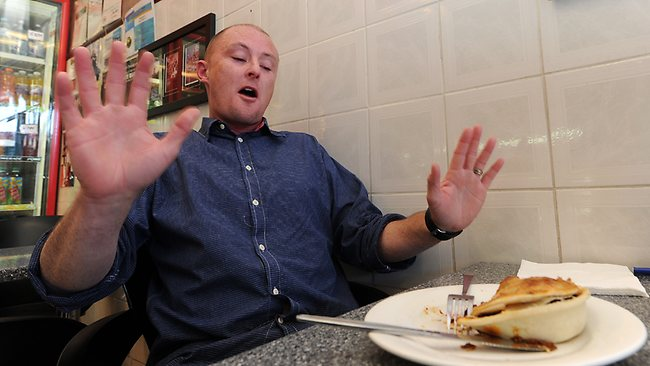 The defeat: The Daily Telegraph journalist Richard Noone tackles the world's hottest pie. Picture: Peter Lorimer