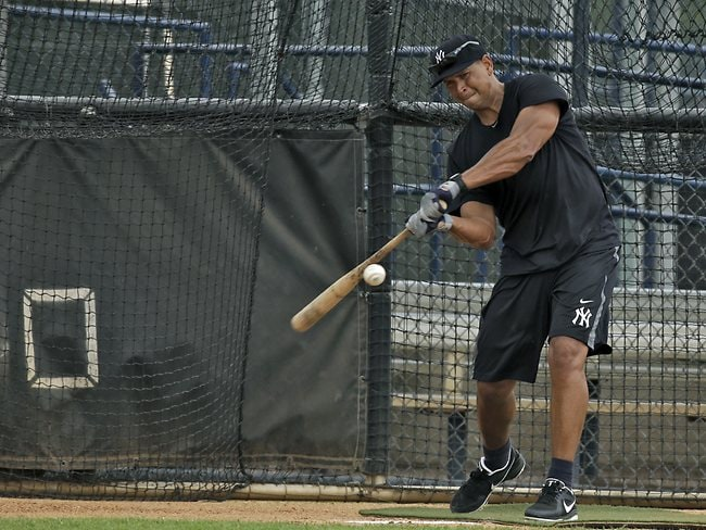 Rodriguez hits the ball in the batting cages.
