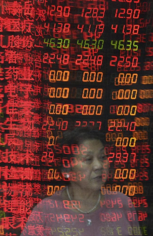 Shares in big Chinese state companies rose but many others sank as jittery small investors looked for ways to cut their losses.