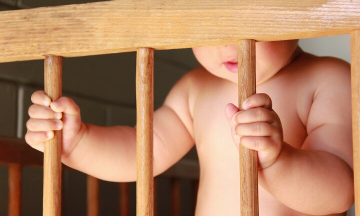 Toddler climbed into baby's cot at childcare centre and 'bit her all over'