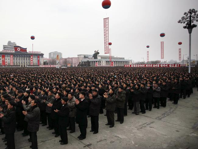 North Koreans gather at the Kim Il Sung Square to celebrate a satellite launch in Pyongyang, North Korea.