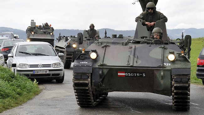 Austrian army soldiers in armoured vehicles arrive near the villages of Grosspriel and Kollapriel some 90 kilometers west of Vienna, Austria, where a man is barricading himself inside a farm building.