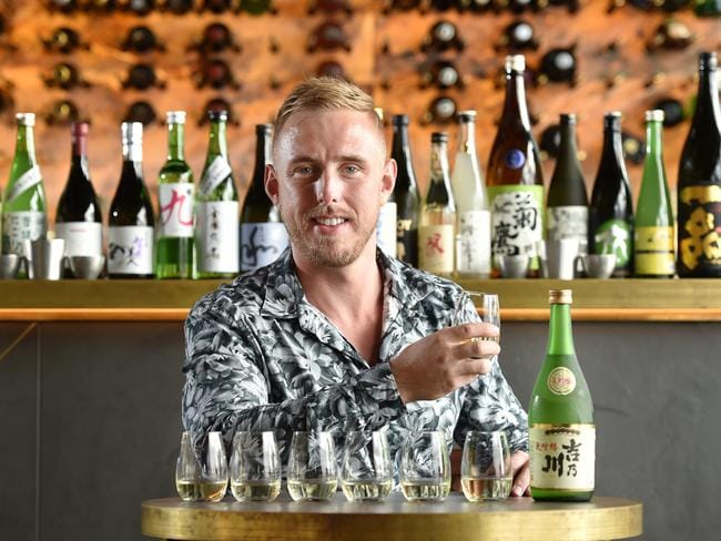 Head sommelier Christopher Entwistle tastes sakes at Fujisaki, Barangaroo. Picture: Troy Snook