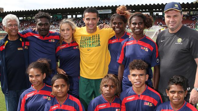 Indigenous children from Australia. and their leader John Moriarty met with Tim Cahill and Ange Postecoglou at Socceroos training. Pic: George Salpigtidis