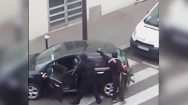 Pure evil ... the pair calmly reload their weapons on the roof of their stolen car before driving off.