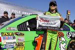 QUEEN of the track, NASCAR driver Danica Patrick displays the flag after taking pole for the Daytona 500 Sprint Cup Series. Picture: Terry Renna