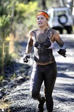 <p>Former waterski world champion Lauryn Eagle takes part in the World Tough Bloke Challenge at Appin in Sydney's southwest. Picture: Simon Bullard</p>