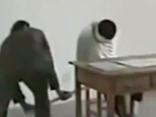 This video footage taken in 2012 shows a detainee's legs being twisted by a North Korean security agent. Picture: Screengrab/LiveLeak