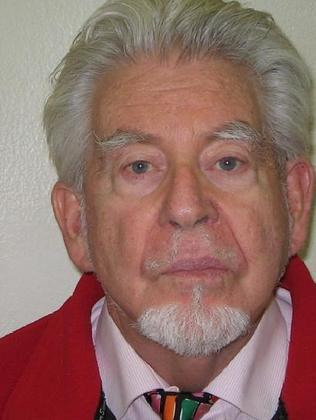 His mugshot ... Rolf Harris's photograph taken by police when he was arrested.