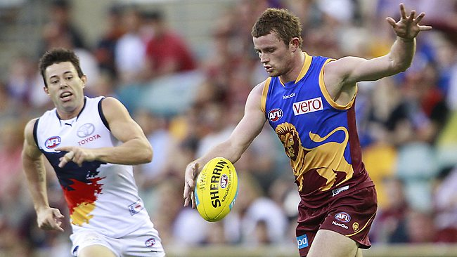 IRISH FIRE: Pearce Hanley in action for the Lions against the Crows at the Gabba. Picture: Jono Searle
