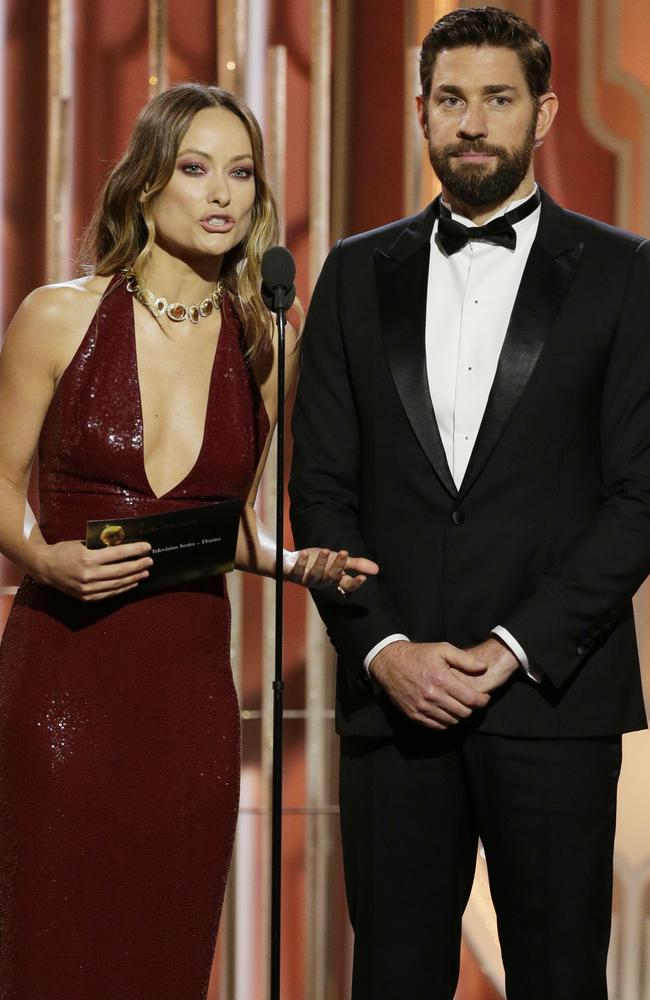 Presenters Olivia Wilde and John Krasinski onstage during the 73rd Annual Golden Globe Awards at The Beverly Hilton Hotel on January 10, 2016 in Beverly Hills, California. (Photo by Paul Drinkwater/NBCUniversal via Getty Images)