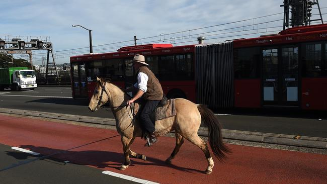 This is how you protest farming issues, on horseback — not facebook. Picture: Dan Himbrechts/AAP