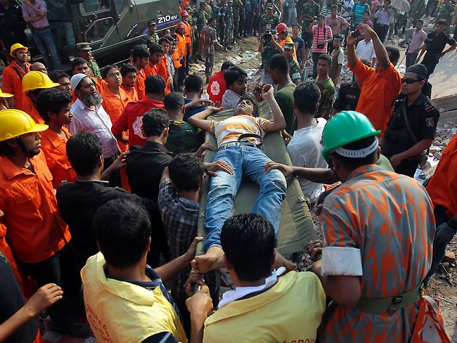 Bangladesh factory collapse: Rescuers carry a survivor out from the debris of a building that collapsed in Savar, near Dhaka, on April 24, 2013. Photo: AP/Munir Zaman
