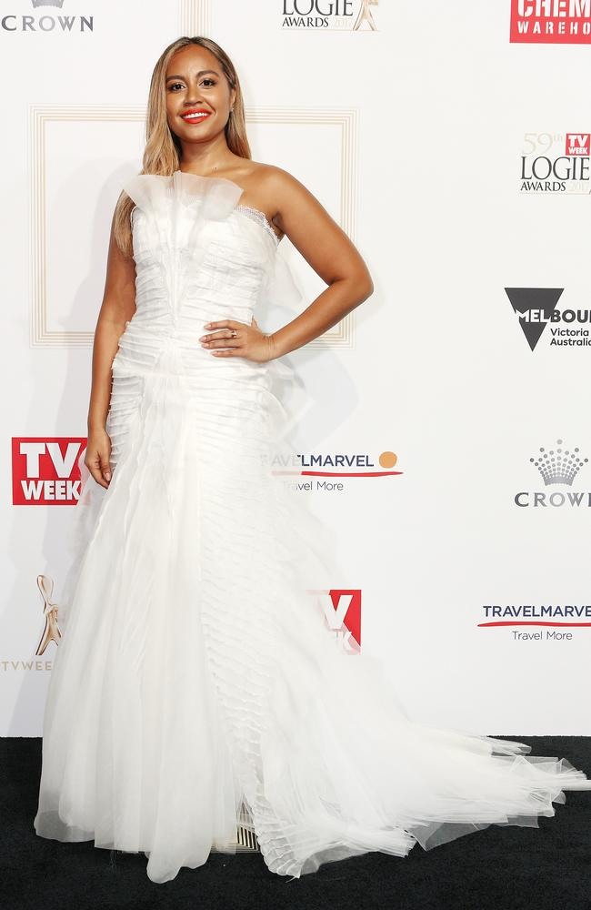 Jessica Mauboy waltzes into the Logies in white.