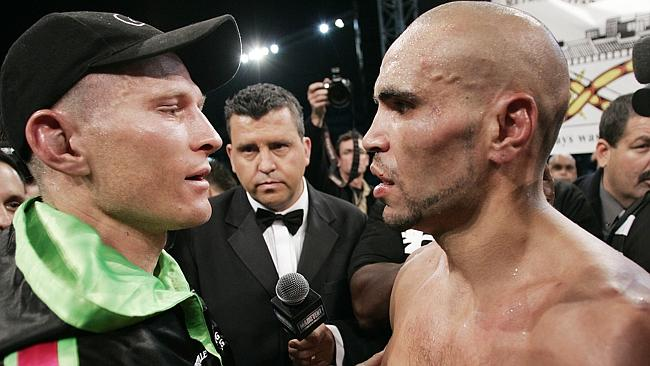 Anthony Mundine, talks with opponent Danny Green after winning their WBA super-middleweight world title eliminator fight in 2006.